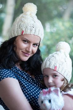 4787cdaf8da White knit hats   Cable knit hats   Matching knit hats   Pom