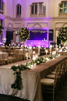 How to transform an open ballroom with stunning decor | Sapphire Events | Greer G Photography | Board of Trade | White and Gold Wedding | Winter Wedding Inspiration | White and Green Wedding | Ballroom wedding | long floral garland #WeddingIdeasGreen