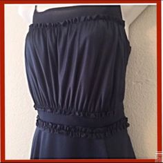"HP Max & Cleo high quality satiny dress Quality dress with satiny feel, ruffled top and tiered hem. Recently dry cleaned. Like new condition. Navy blue. Adjustable straps Length is 33"" not including the adjustable straps  16"" across the bust in front and 14"" across waist in front. Also has a side zipper. Polyester blend. Max & Cleo Dresses"