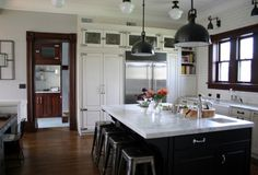 Love the uppermost cabinets with the thin subway tile accent above.