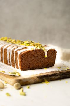 An easy dairy-free pistachio and lemon loaf cake with the addition of cardamon spice and finished off with a tangy lemon drizzle. Lemon Loaf Cake, Lemon Drizzle Cake, Cardamom Cake, Cake Recipes, Dessert Recipes, Winter Desserts, Spice Cake, Almond Recipes, Perfect Food
