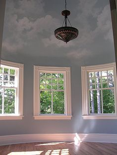 Great cloud-painted ceiling; Eclectic Guest Bedroom - Come find more on Zillow Digs!