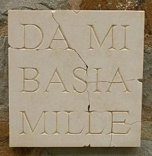 """Give me 1000 kisses"", ancient Italian street sign in stone. #romance #ancient #stonework"