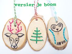 """Christmas Decoration; Cut slices of a branch into discs, use a small drill bit to make the """"embroidery"""" design, then stitch with thick floss/thread. Draw owl/reindeer with black pen or use a wood burning tool."""