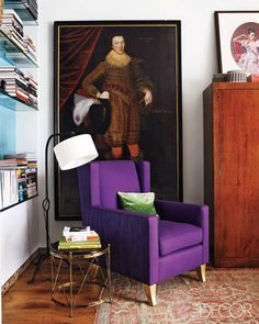 A SoHo Loft with French Flair-A corner in the library features a metal floor lamp, a Couturier-designed armchair, and a stool by Jean-Michel Frank; the portrait of Sir Richard Broke is by Gilbert Jackson.