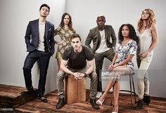 Actors George Young, Kristen Gutoskie, Chris Wood, David Gyasi, Christina Marie Moses, and Claudia Black of 'Containment' pose for a portrait at the Getty Images Portrait Studio Powered By Samsung Galaxy At Comic-Con International 2015 at Hard Rock Hotel San Diego on July 11, 2015 in San Diego, California.