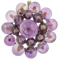 We are in awe of this Victorian Amethyst flower pendant and brooch! Complete with twenty juicy and plump Amethysts, this brooch doubles up as a pendant, meaning you have two ways to wear her!pWith a lovely lavender purple hue, this unique piece will certainly set your antique jewellery collection apart from others. We love that this piece is feminine and fun, there's nothing else quite like it!pERA: Victorian (1837-1901).pMEASUREMENTS: 40mm in diameter x 18.5mm deep. brCentral Amethyst measures Victorian Life, Amethysts, Purple Hues, Antique Jewellery, Flower Pendant, Jewelry Collection, Lavender, Feminine, Pendants