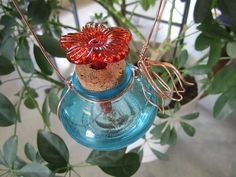 SAVE 10% use coupon code PIN10 This glass #hummingbird #feeder is made of one jar (COLORS LISTED BELOW,) accented with copper or nickel wire, the wire is shaped into bell flowers.  AVAILABLE BEAN JARS COLO... #housewares #outdoor #decorative