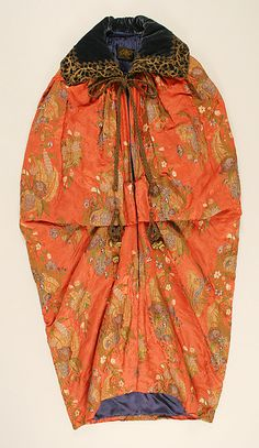 <P>A woman's complete wardrobe from the House of Worth was sure to include outerwear like this padded evening coat of silk brocade with a floral motif on a figured satin ground. Worth's sons kept many of the key elements of their father's designs alive, such as references to historic dress