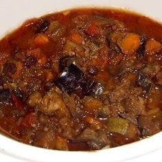 A hearty vegetarian stew with pumpkin, zucchini, eggplant and okra. Set it up in the slow cooker in the morning and it will be ready for dinner. Crock Pot Slow Cooker, Crock Pot Cooking, Slow Cooker Recipes, Crockpot Recipes, Cooking Recipes, Vegetarian Stew, Vegetarian Recipes, Healthy Recipes, Healthy Potluck