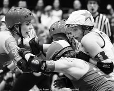 Xena contends with the Angel City defence in the game between @ratcityrollergirls and @angelcityderby at the @wftda 2015 Championship in Saint Paul. #wftda #wftdachamps #ratcityrollergirls #ratcity #embracethegray #angelcityderbygirls #acdg #rollerderby by maninthebowlerhat