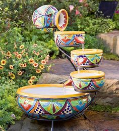 The sights and sounds of this Talavera fountain lend a festive feeling to porch, patio or sunroom. Glazed ceramic vessels overflow in a continuous cycle of cascading water. Authentic color and design create a low-maintenance display. Handmade in Mexico Mexican Style, Mexican Art, Mexican Garden, Mexican Home Decor, Mexican Decorations, Garden Waterfall, Waterfall Fountain, Talavera Pottery, Garden Fountains