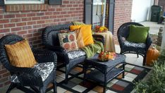 My front porch, all decorated for fall. We painted the old white wicker furniture black and now it looks brand new again! I also made new cushions and pillows with fabrics I found on sale.