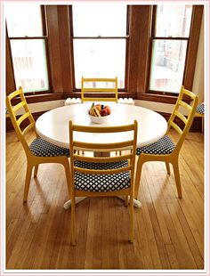 painted chairs and table.  pink dining room with yellow and black.
