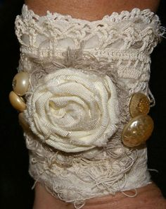 Another elegant beauty. Antique pearl buttons and a handmade taffeta rosette later atop layers of repurchased fabric and vintage trims. Fabric Bracelets, Lace Bracelet, Wedding Bracelet, Cuff Bracelets, Wedding Jewelry, Lace Jewelry, Textile Jewelry, Fabric Jewelry, Handmade Jewelry