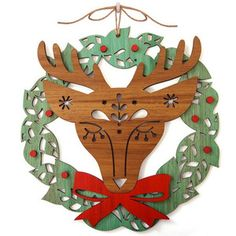 Deer head Christmas Wreath by Andrea Smith and Candy Stripe Cloud.  This beautiful Christmas Wreath is laser cut from 4mm wood, it is then  stained and the top layer (face bow & red dots) are then attached to the wreath base. It is designed, laser cut and assembled by hand in Sydney. $80