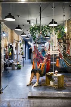 This juice bar takes relaxing to a whole new level with a selection of seating options, that include hammocks, benches, circular nooks and stationary bikes.