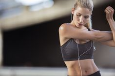 Woman stretching arms before exercise -