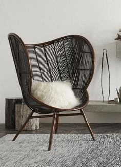 """Inspired by Danish Modern Design Stained rattan in mahogany and ebony tones Hand-woven 37 1/2"""" l x 36"""" w x 49 1/2"""" h Seat height 16"""" Ships by freight Please all"""