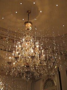 crystals hanging from clear thread surrounding the chandelier and sharing the light to sparkle, Beautiful Paris, Beautiful Lights, Lamp Light, Light Up, Hanging Crystals, Chandelier Crystals, Crystal Chandeliers, Beaded Chandelier, Home And Deco