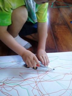 tape markers to toy vehicles and drive around to draw.