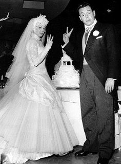 Desi Arnaz wedding to Lucille Ball (1940) ... never would have pictured her in such a dress and headpiece ... I kinda like it.