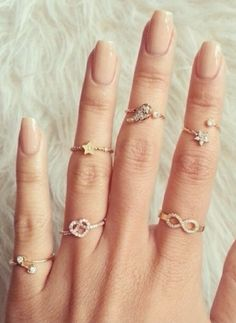 stacking rings + nude nails