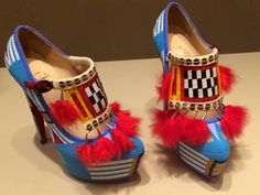 Christian Louboutin high heel shoes with Native art by Jamie Okuma at the Minneapolis Institute of Arts.