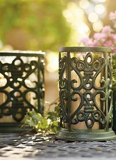 Elegant scrollwork and Parisian ironwork combine with the romantic glow of any candle to create the Fleur-de-Lis Hurricane that creates an inviting ambiance in your outdoor space.
