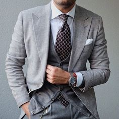A grey suit and a grey cardigan? This menswear style will turn every head in the proximity. Grey Suit Men, Mens Suits, Grey Suits, Gents Wear, Dress With Cardigan, Grey Cardigan, Dress Shirt, Bespoke Suit, Classy Men