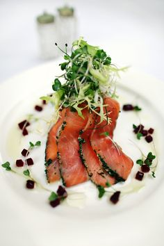 Starter of cured salmon, microgreens and beetroot brunoise.