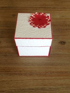 Red and white birthday explosion box.