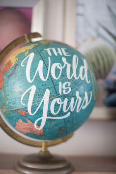 """The World is Yours"" globe from a 365 Days on Earth First Birthday Party on Kara's Party Ideas 