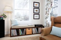 record storage problem solved! this is an expidit ikea shelving unit that has rave reviews from LP collectors on its sturdiness. it looks well done in this set up and i love the idea of using it as a window seat. each square holds 90-100 LPs.