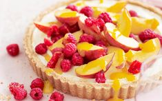 Peach and raspberry tart with mango coulis