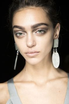 Giorgio ArmaniLinda Cantello gave models' skin a pale, matt appearance at Giorgio Armani using a white base, complemented by sandy-coloured lips and full brows.