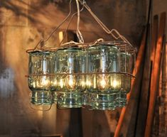 Rescue old bottles and mason jars from the bin and transform them into this gorgeous chandelier. You can give it a rusty look that will make it look even more artistic and antique. The chandelier will leave a high impact in any corner of the house. Everyone will love the way it is created, used and appreciated.