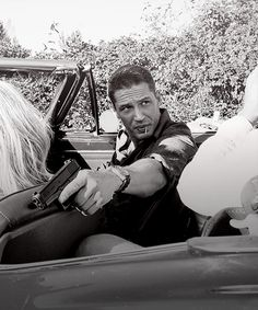 My obsession with Tom Hardy is reaching new heights. Those lips + a gun = SEX.