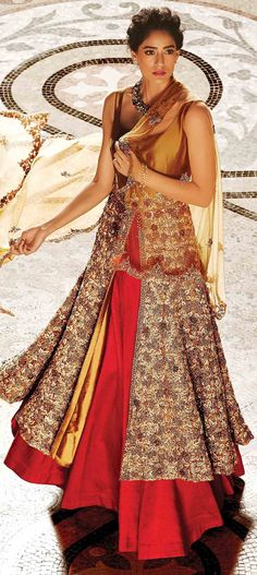 Buy Online from the link below. We ship worldwide (Free Shipping over US$100). Product SKU - 254986.Product Link -  http://www.kalkifashion.com/long-jacket-lehenga-in-beige-and-gold-enahnced-in-beads-and-sequin-embroidery-only-on-kalki.html