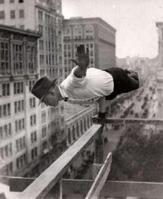 firsttimeuser:  Acrobatics. A very large extent is a man horizontally, through an arm, a scaffolding. New York, 1921