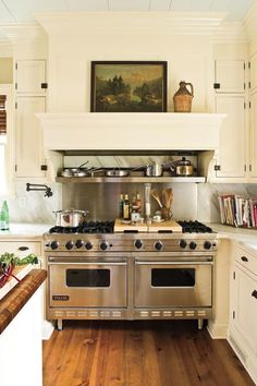 Jamie designed a mantel-like whitewashed hood to top the commanding stainless steel range. A favorite work of art, displayed on its ledge, adds warmth to the space.