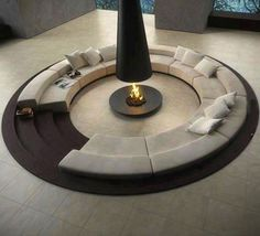 Awesome indoor circular firepit couch.