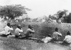 JAPANESE MURDER SIKH PRISONERS: CAPTURED ATROCITY PICTURES, C. 17 SEPTEMBER 1945. This set of four atrocity pictures was found among Japanese records when British troops entered Singapore. The pictures clearly show the inhuman brutality practised by the Japanese upon their helpless prisoners. Japanese soldiers shooting Sikh prisoners who are sitting blindfolded in a rough semi-circle about 20 yards away.