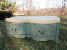 This fantastic mahogany bench was made from part of an old dresser!It is painted in Annie Sloan Chalk Paint Provence with dark wax, which is over a gold painted textured base put on that is meant to look like old tin. It has the original drawer pulls which resemble oiled bronze