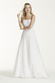 Chiffon A-line gown with side draped bodice, beaded lace, and lace up back.   Sweep train. Available in stores and online in White. Ivory available online only.  Woman: Style 9V9409. Sizes 14W-26W.  (Select Stores and Special Order Only).  Imported Polyester. Dry Clean.  To preserve your wedding dreams, try our Wedding Gown Preservation Kit.