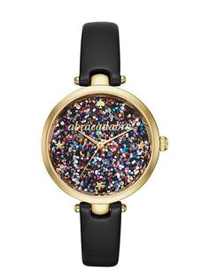 "add a little magic to every day. the gold-tone kate spade new york holland watch gleams with a multicolored glittering dial with ""abracadabra"" in gold-tone script, star and crystal indexes and a sleek"