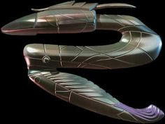 The Zat gun, short for Zat'nik'tel, is a Goa'uld weapon in the Stargate universe. One shot of the blue energy the Zat discharges will incapacitate the target with immense pain. A second shot will kill and a third, in quick succession, will cause disintegration. The weapon has a serpentine shape which springs forward when activated. The Zat is either a merciful weapon, having a non-lethal function, or a weapon of intimidation (the non-lethal function hurts like hell).