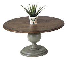 Progressive Colonnades Round Pedestal Coffee Table - Enjoy ample tabletop space when you add the Progressive Colonnades Round Pedestal Coffee Table to your home. Knotted oak accents and a weathered gray...