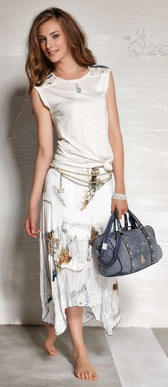 Lookbook Collection | Daniela Dallavalle. Love the large pocket on the skirt and the different shoulder fabric choices.
