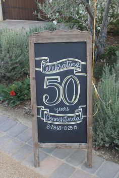 Sandwich board to greet guest for a 50th Wedding anniversary party